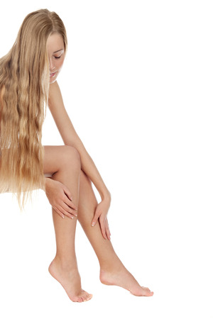 naked legs: Girl with loose hair is caring for her legs