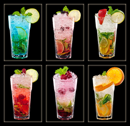 Collection of colorful tropical cocktails  isolated on black background photo