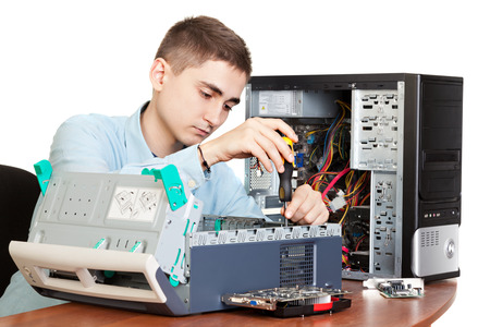 Technician repairing computer hardware in the lab   Studio shot   photo