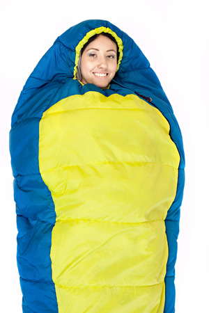 Camping young woman in sleeping bag  isolated on white background. photo