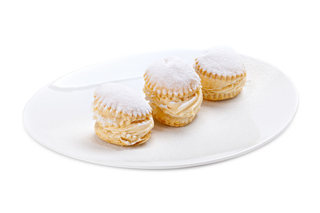 creampuff: cream cakes on a plate.Isolated on white background.