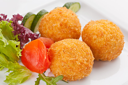 Traditional Italian food of rice with fillings, covered with bread crumbs, and fried.