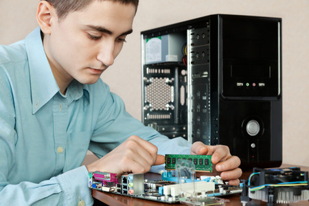 Technician repairing computer hardware in the lab.