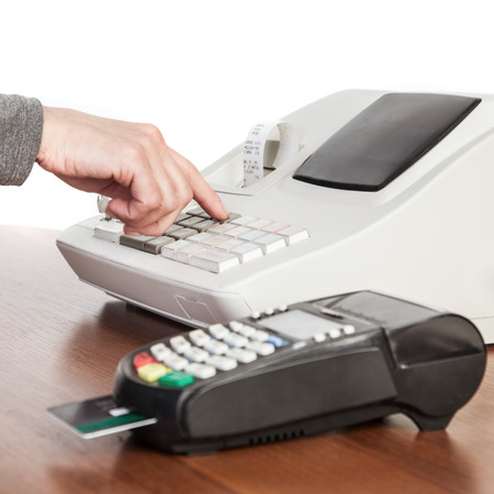 The seller makes the calculation and takes payment by a cash register and credit card reader.