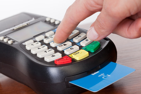 eftpos: Close-up of cards servicing with POS-terminal Stock Photo
