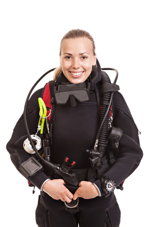 scuba: Attractive blonde female underwater swimmer wearing black wetsuit with diving equipment. Isolated on white background. Stock Photo