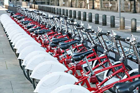 Group of bicycles in the row. Bikes for rent docking station. Selective focus.