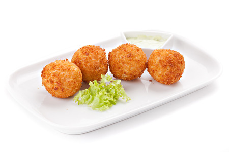 Deep fried cheese balls with  lettuce and sauce, isolated on white background Standard-Bild