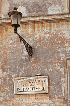 Piazza Di San Maria in Trastevere  sign on a wall at square, Rome Italy photo