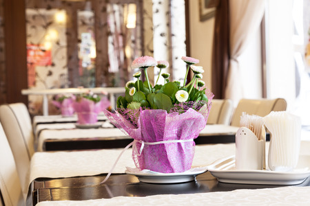 beautify: Flowers adorn the table in the restaurant. Stock Photo