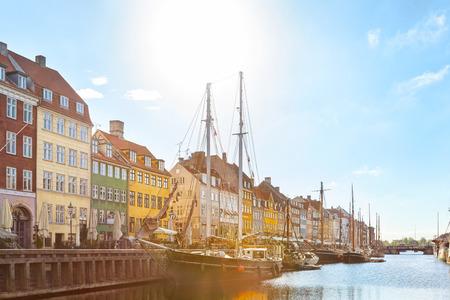 The Nyhavn harbour in a sunny day.COPENHAGEN, DENMARK .