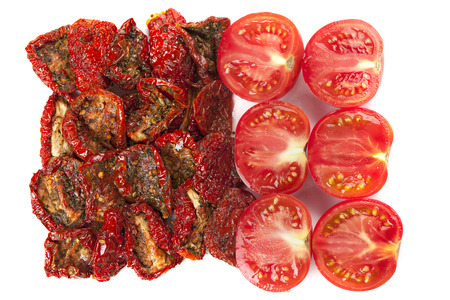 sundried: Slices of sun-dried and fresh tomatoes isolated on white background