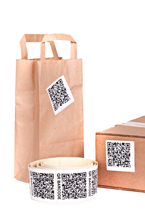 stocktaking: Packaging boxes marked with a bar code, isolated on white background. Studio short.