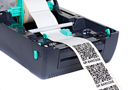 stocktaking: Barcode Label  Printer, isolated on white background. Studio short. Barcode for use - no copyright issues as constructed.