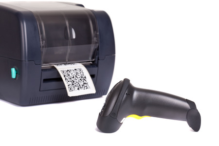 Label Printer and  Wireless Barcode Scanners, isolated on white background. Studio short. Barcode for use - no copyright issues as constructed.