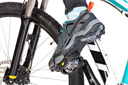 clasp feet: View from below of special contact shoe attached to the bicycle pedal.