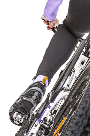 pedaling: Close up rear view cyclist pedaling bike isolated on white background