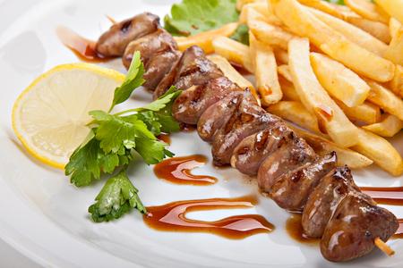 kebab: Plate of freshly prepared kebabs and fries