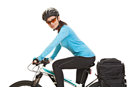 saddlebag: Female mtb cyclist  with saddlebag, looking at the camera and smiling, isolated on white background. Studio shot. Rear view.