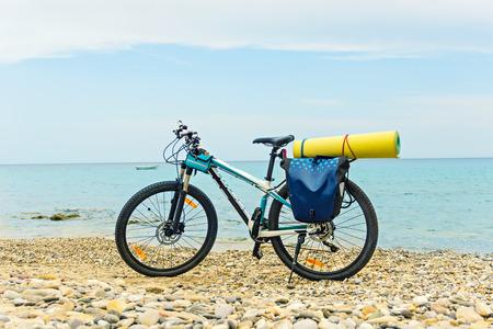 saddlebag: Parked at the beach mountain bike ready to travel.
