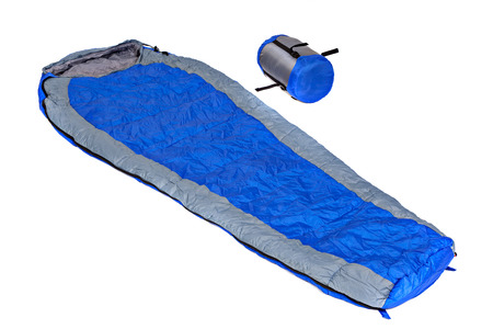 Two of the  sleeping bags in a compression bags and unpacked isolated on white background. Studio shot.