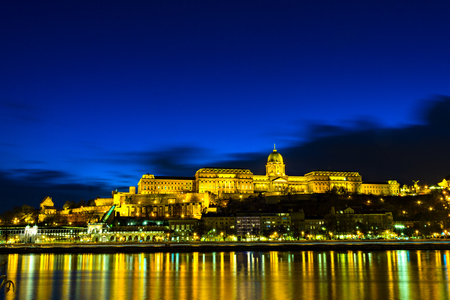 Illuminated building of Buda Castle and Chain bridge at night in  Budapest.  Hungary. 写真素材