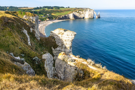 Beautiful natural rock arch. Aval cliff. Etretat, Normandy, France.