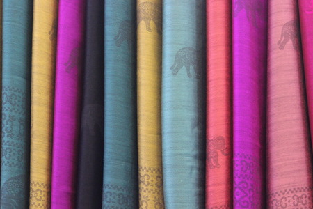 cloth manufacturing: textiles, set of colorful fabrics. ethnic motifs, elephants, patterns