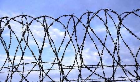 Barbed wire against the sky Stock Photo - 8143182
