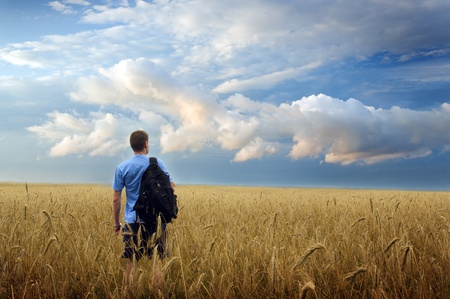 Man in yellow wheat meadow. Conceptual design. Stock Photo - 11304874