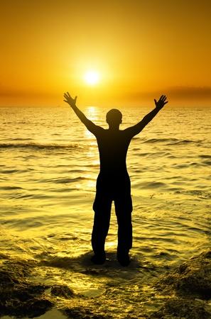 silhouette of man on majestic dawn