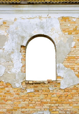 Window in a wall of an old building photo