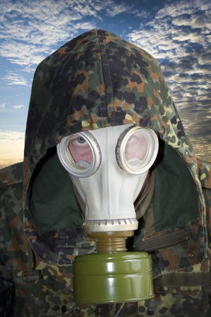 Portrait of man in gas mask photo
