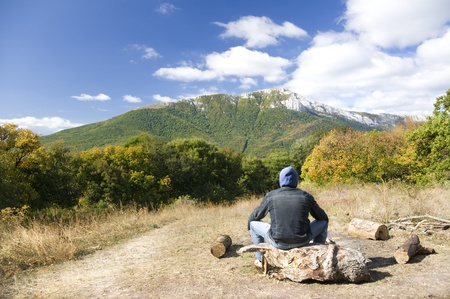 Man tourist in mountains forest. Leisure activity. Stock Photo - 11604059