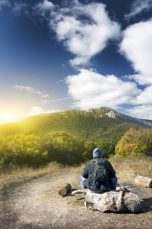 Man tourist in mountains forest. Leisure activity. Stock Photo - 11604060
