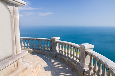 Kind on ocean from a stone balcony Stock Photo - 11604148