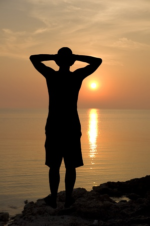 silhouette of man on the sunset photo