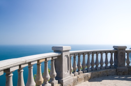 Kind on ocean from a stone balcony Stock Photo - 12778760