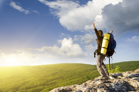 Man on top of mountain  Conceptual design  Stock Photo