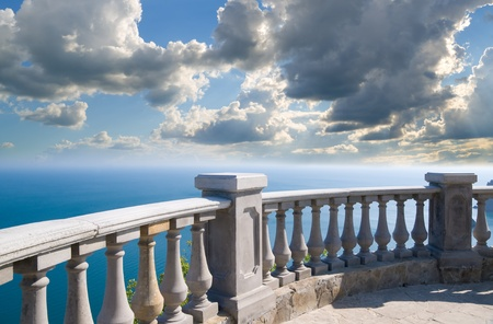 Kind on ocean from a stone balcony Stock Photo - 12778768