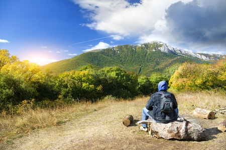 Man tourist in mountains forest. Leisure activity. Stock Photo - 12625463