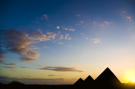 Pyramids in Giza valley under sunset light Stock Photo