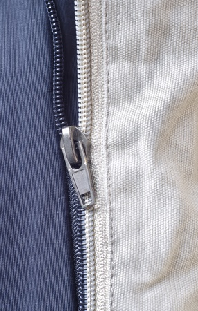 Opened zipper revealing a white background. photo