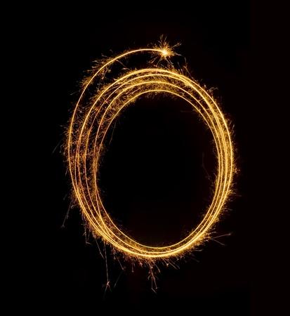 Framework from sparkling fireworks on a black background photo
