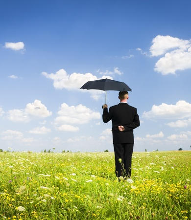The person with an umbrella in the field