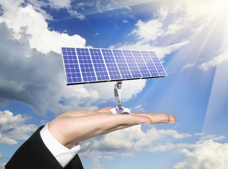 photoelectric: photoelectric cells of a solar panel on human palm
