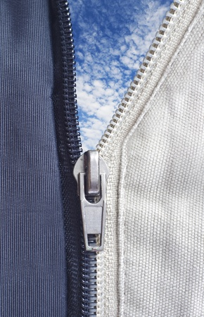 Opened zipper revealing a white background Stock Photo - 12625490