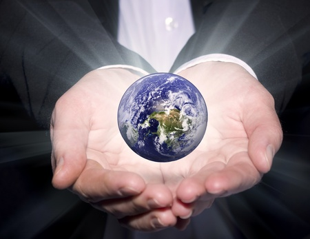 Business man Hold the Earth photo