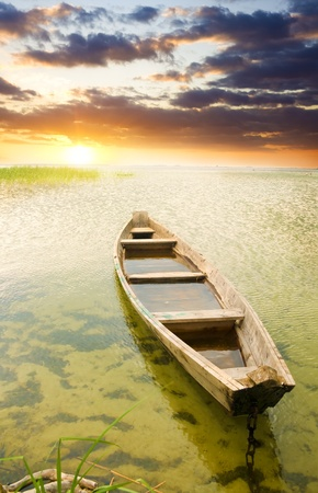 Boat at coast against asunset  Nature composition Stock Photo - 13264153