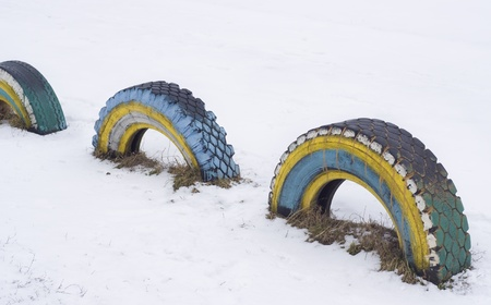kinder garden: The decorated automobile tyre covers on a children